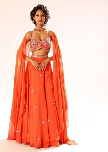 Coral Lehenga Choli With 3D Resham Embroidered Flowers And Matching Choker With Attached Cape Online - Kalki Fashion