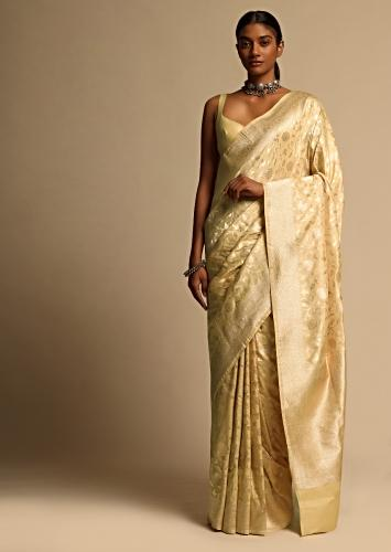 Cream Beige Banarasi Saree In Pure Handloom Silk With Woven Floral Jaal And Floral Border Along With Unstitched Blouse Piece Online - Kalki Fashion