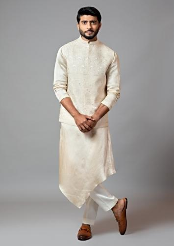 Cream Nehru Jacket In Kora Fabric Featuring Mughal Embroidery And Paired With Drape Kurta And Pajama By Smriti Apparels