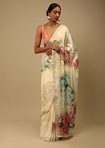 Cream Saree In Satin Crepe With Rose Print And Kundan Detailed Border Along With Unstitched Blouse Online - Kalki Fashion