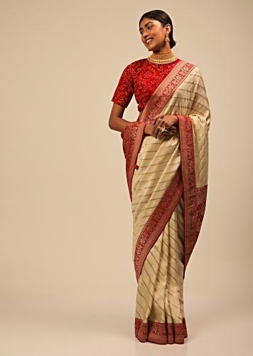 Cream Saree In Silk With Diagonal Stripes And Red Brocade Bandhani Pallu And Border Along With Unstitched Blouse Online - Kalki Fashion