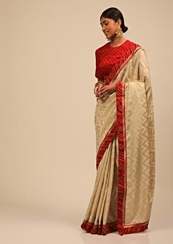 Cream Saree In Silk With Lurex Woven Chevron Design And Red Bandhani Border Along With Unstitched Blouse Online - Kalki Fashion