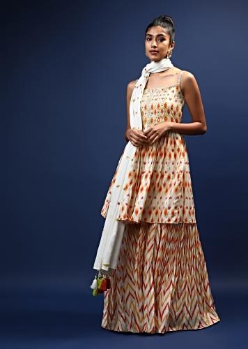Cream Sharara And Peplum Suit In Crepe With Ikkat Print And Mirror Accents Online - Kalki Fashion