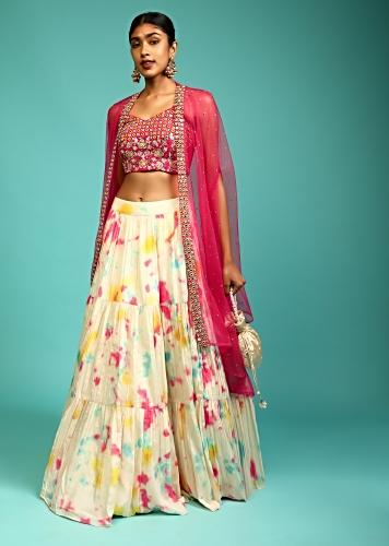 Cream Tie Dye Printed Skirt And Hot Pink Crop Top Set With Mirror Abla Embroidery And Net Cape Jacket Online - Kalki Fashion