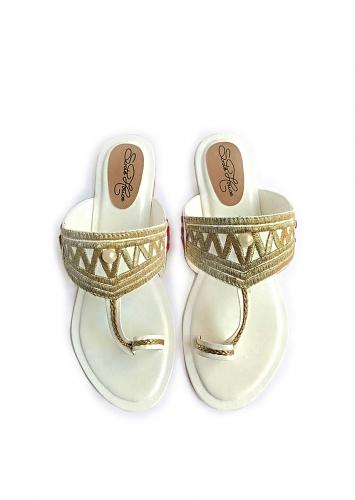 White Kolhapuri Flats With Traditional Zari Work In Zigzag Design And Accents Of Red Velvet Rose Patchwork Online By Sole House