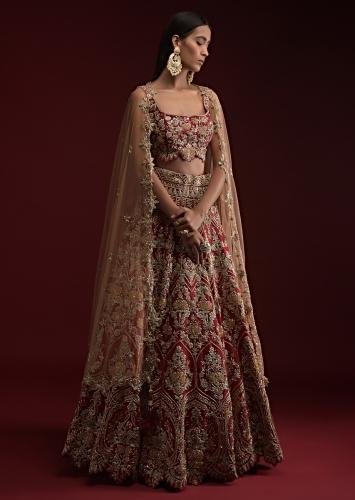 Deep Red Lehenga Choli In Raw Silk With Had Embossed Embroidery Work In Heritage Floral Motifs And Cutwork Hemline Online - Kalki Fashion
