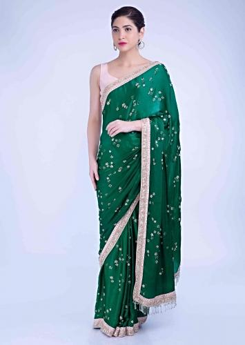 b271d1f76e Emerald green satin georgette saree with blush pink raw silk blouse piece  only on Kalki
