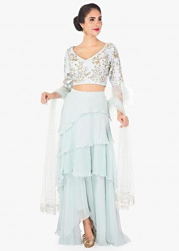 8e9fcd029f Frost blue layered skirt cut dana blouse and net blouse only on Kalki