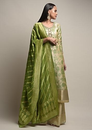 Gold Beige Palazzo Suit With Woven Floral Jaal And Green Dupatta With Bandhani And Brocade Design Online - Kalki Fashion