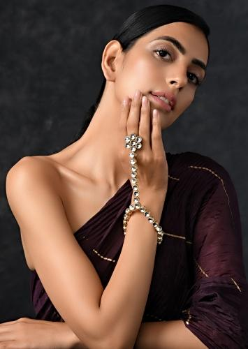 Gold Plated Hand Harness With Beautifully Handcrafted Floral Design Adorned In Kundan Work By Paisley Pop