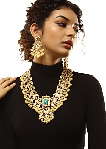 Gold Plated Kundan Necklace And Earrings Set With Green Carved Stone Pendant And Edged With Yellow And White Pearls By Kohar