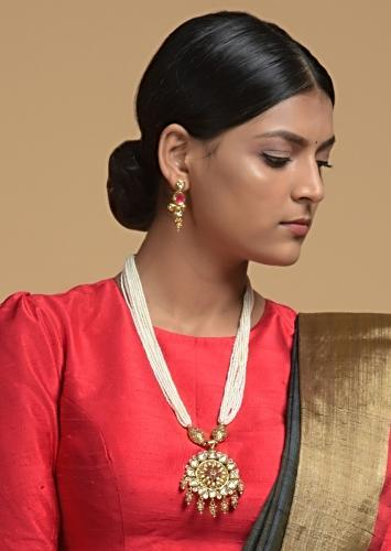 Gold Plated Kundan Necklace And Earrings Set With Pink Stone Studded Floral Motif And Strings Of White Beads Online - Kalki Fashion