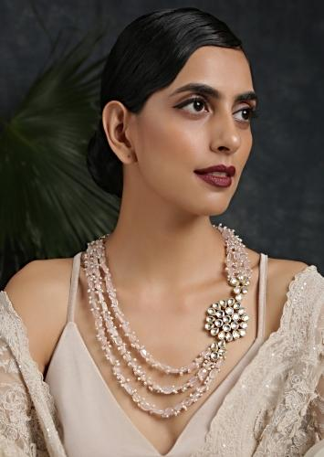 Gold Plated Layered Necklace Featuring Pastel Pink Stones And Moti Along With A Kundan Pendant On The Side By Paisley Pop