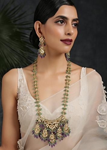 Gold Plated Long Kundan Necklace Set Handcrafted With An Elaborate Pendant Featuring Green And Purple Dangling Stones By Paisley Pop