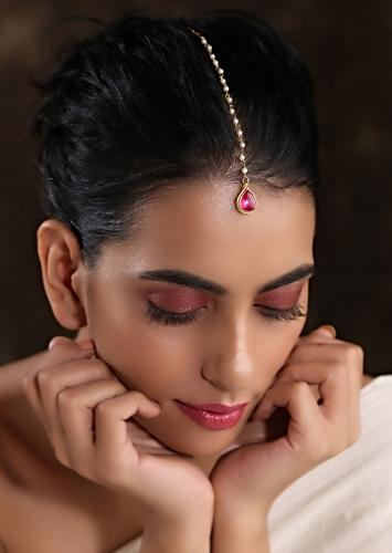Gold Plated Maang Tika With Pink Drop Shaped Stone And Moti Embellished Chain By Paisley Pop