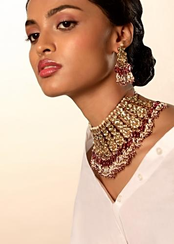 Gold Plated Necklace And Earrings Set With Kundan And Moti Work In Ethnic Motifs Along With Rani Pink And White Bead Fringes By Kohar