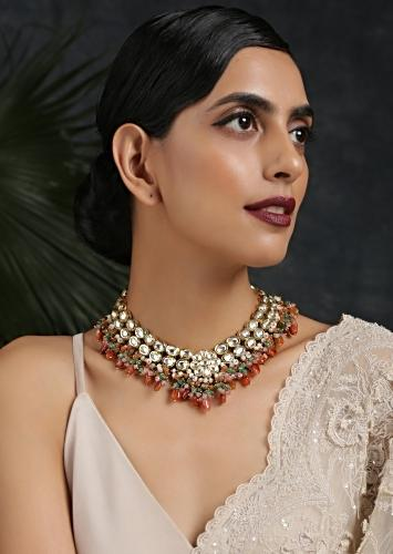 Gold Plated Necklace Encrusted With Kundan Along With Dangling Orange And Green Beads By Paisley Pop