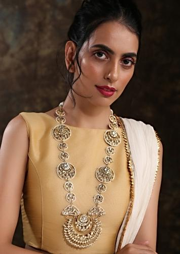 Gold Plated Royal Kundan Necklace Handcrafted In An Elegant Design With Dangling Pearls  By Paisley Pop