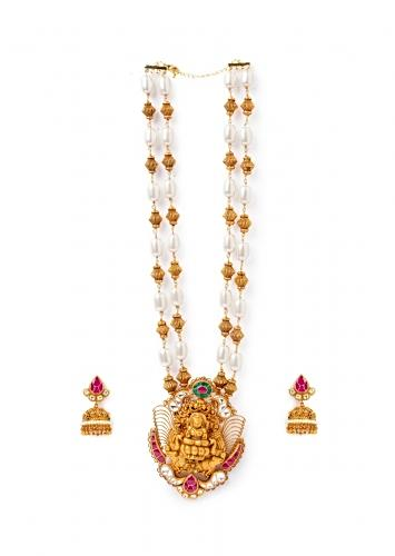 Gold Plated Temple Necklace And Earrings Set With Carved Goddess Motif And Studded With Hydro Polkis, Carved Beads And Shell Pearls Online - Joules By Radhika