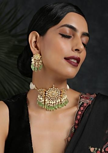 Gold Plated Uncut Kundan Necklace Set With Earrings Embellished With Emerald Green Stones By Paisley Pop