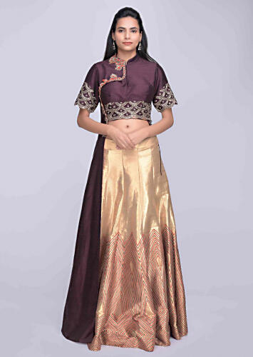 1ab4e92ce5 Gold silk lehenga with burgundy crop top with attatched half jacket only on  Kalki