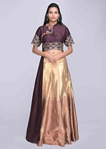 4470a85485 Gold silk lehenga with burgundy crop top with attatched half jacket only on  Kalki