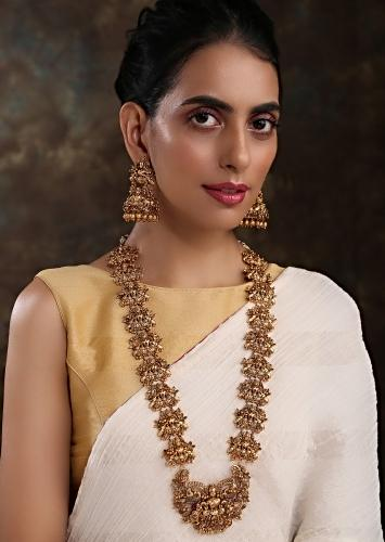 Gold Temple Necklace Set Featuring Emboss Work And Studded With Red High Grade Red Stones By Paisley Pop