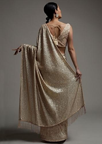 Gold Beige Saree In Sequins Fabric With Fringes On The Pallu And Unstitched Blouse Online - Kalki Fashion