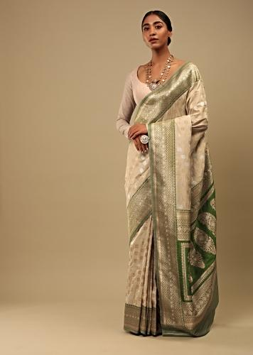 Golden Beige Saree In Pure Handloom Silk With Green Woven Border And Two Toned Buttis Along With Unstitched Blouse Online - Kalki Fashion