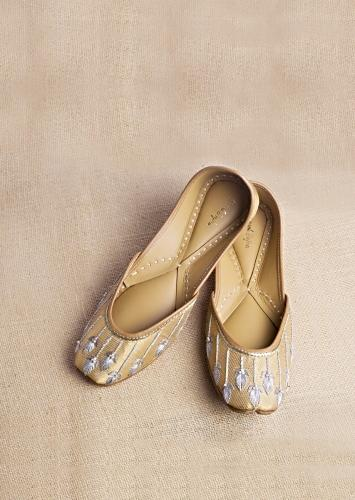 Golden Juttis In Banarasi Fabric With Silver Zari Embroidery Along With Fresh Water Pearl Accents By Vareli Bafna