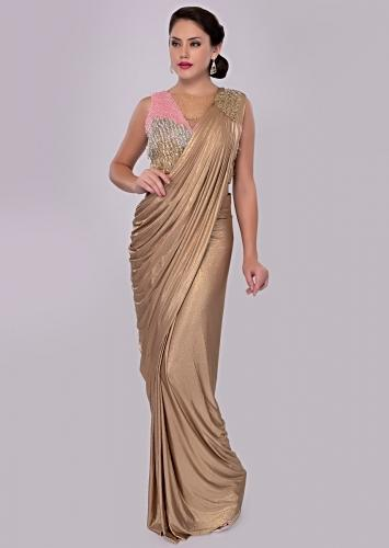 6100733eeba Golden wrap around shimmer lycra saree with multi color sequins net blouse  only on kalki