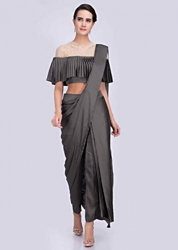 82fcaef9efb0 Graphite grey dhoti saree with fancy cape style crochet blouse only on Kalki