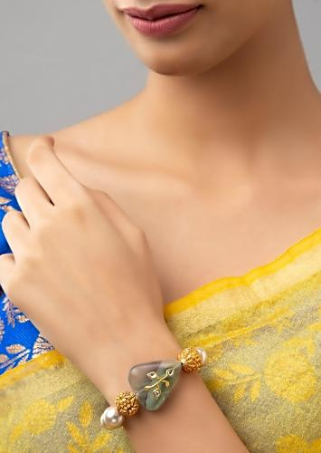 Green Fluoride Tumble Bracelet With Carved Floral Gold Plated Beads And Exquisite Shell Pearls Online - Joules By Radhika