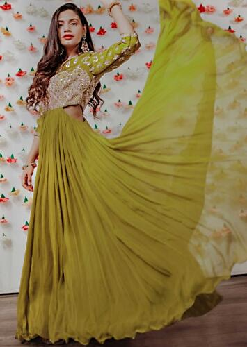 fd9a9a7ad7 Green georgette anarkali with embroidered bodice and cut out from the sides  only on kalki