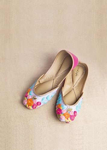 Grey Juttis In Raw Silk With Multicolored Thread Embroidered Flowers That Give A Fresh Vibe By Vareli Bafna