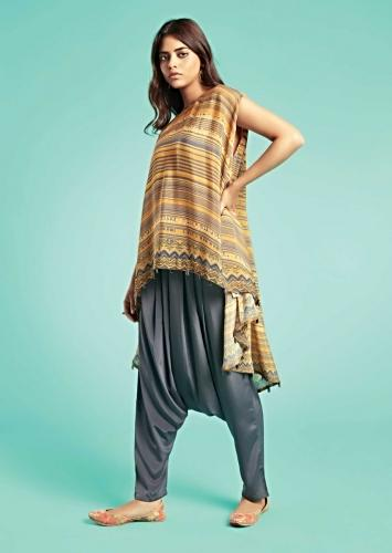 Honey Yellow Cape Top With Printed Stripes And Tribal Pattern And Grey Low Crotch Pants Online - Kalki Fashion