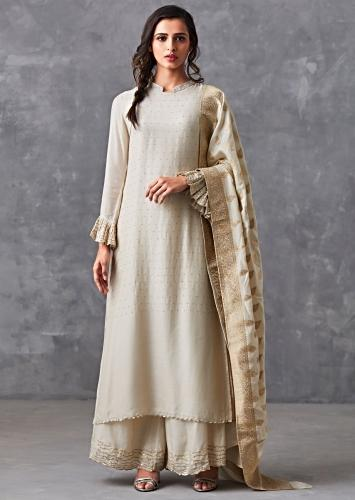 f8364a270c12 Ivory straight suit adorn in badla work matched with palazzo suit