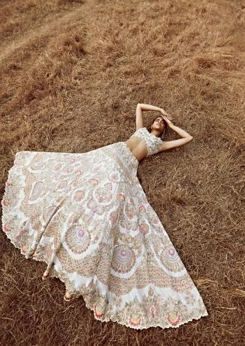 Ivory White Lehenga Choli In Raw Silk With Colorful Resham And Cut Dana Embroidered Summertime Flowers And Heritage Motifs Online - Kalki Fashion