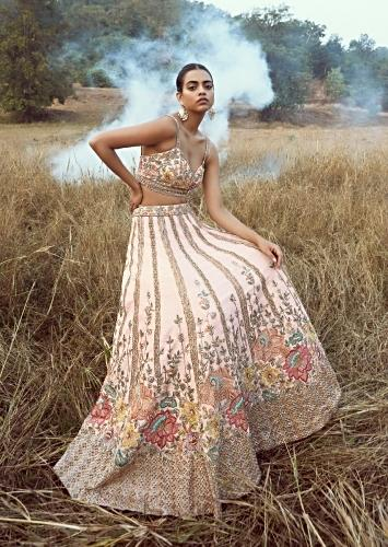 Ivory White Lehenga Choli In Raw Silk With Colorful Resham Flowers Along The Hemline And Vertical Embroidered Kali Detailing Online - Kalki Fashion