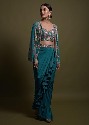 Kreetika Sharma In Kalki Teal Frill Draped Skirt With Embroidered Blouse And Cape Style Net Jacket Online - Kalki Fashion
