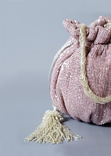 Lavender Potli Bag In Sequins Fabric With Cut Dana Tassels And Handle By Solasta