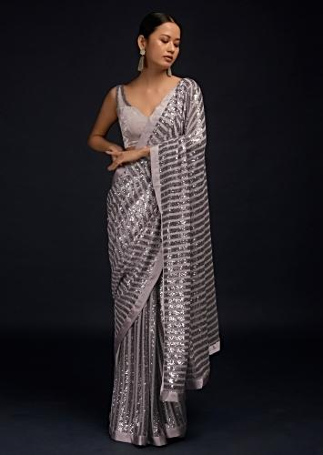 Lavender Ready Pleated Saree In Net With Sequin Embellished Stripes And Velvet Crop Top With Sequins On The Shoulders Online - Kalki Fashion