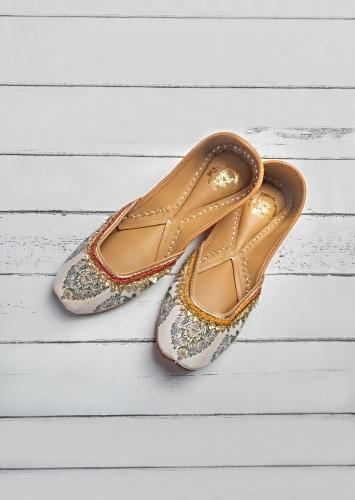 White Juttis In Cotton Satin With Printed Ethnic Pattern Along With Gotta Patch And Colorful Lace  By Vareli Bafna