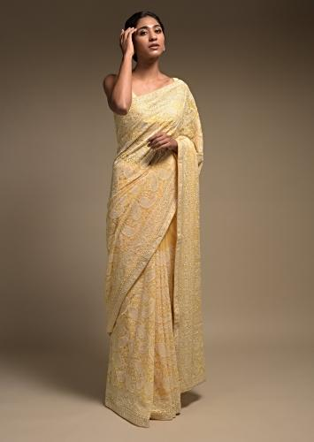Macaroon Yellow Saree In Georgette Adorned With Lucknowi Thread Embroidery In Paisley Jaal Online - Kalki Fashion