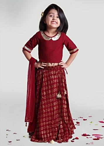Maroon Skirt And Choli Set In Jacquard Blend With Woven Buttis On The Skirt By Mini Chic