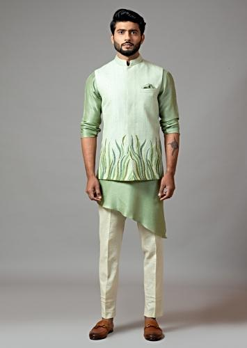 Mint Green Nehru Jacket With Resham Embroidered Grass Design And Paired With Asymmetric Kurta And Pajama By Smriti Apparels