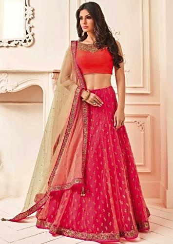 f3c907cf84296 Orange and pink lehenga feautring with zari and embroidered neckline
