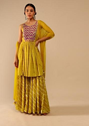 Mustard Peplum Sharara Suit In Crepe With Bandhani And Lehariya Print Paired With Resham And Mirror Embroidery In Scallop Design Online - Kalki Fashion
