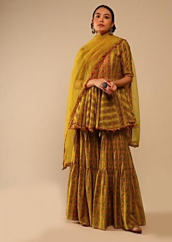 Mustard Sharara Suit In Cotton Blend With Peplum Kurti Adorned In Floral Print And Thread Embroidery Online - Kalki Fashion