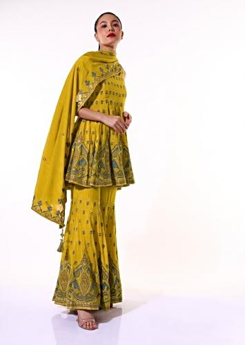 Mustard Sharara Suit With Peplum Kurti Adorned With Colorful Resham Embroidered Geometric Motifs And Butti Design Online - Kalki Fashion